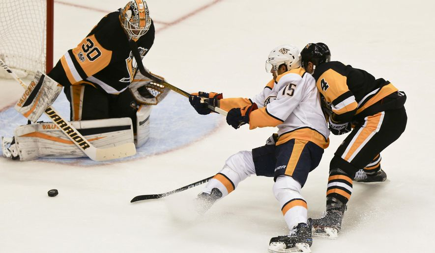 Nashville Predators' Craig Smith (15) loses the puck while skating in on Pittsburgh Penguins goalie Matt Murray as Justin Schultz (4) defends in the first period of the NHL hockey game, Saturday, Oct. 7, 2017, in Pittsburgh. (AP Photo/Keith Srakocic)