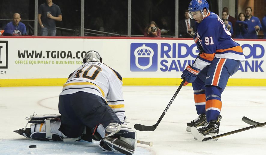 New York Islanders center John Tavares (91) scores a goal past Buffalo Sabres goalie Robin Lehner (40) during the second period of a hockey game, Saturday, Oct. 7, 2017, in New York. (AP Photo/Julie Jacobson)