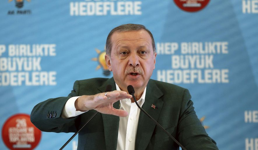 """Turkey's President Recep Tayyip Erdogan, gestures as he delivers a speech at his ruling political party's conference in Afyonkarahisar province in western Turkey, Saturday, Oct. 7, 2017. Erdogan has announced the country is conducting a """"serious"""" operation against extremist groups in Syria's northwestern Idlib province with Turkey-backed rebels. (Yasin Bulbul/Pool Photo via AP)"""