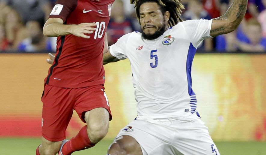 United States' Christian Pulisic (10) tries to get past Panama's Roman Torres (5) during the first half of a World Cup qualifying soccer match, Friday, Oct. 6, 2017, in Orlando, Fla. (AP Photo/John Raoux)