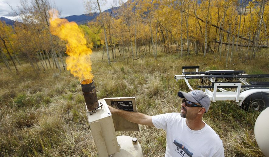 In this Wednesday, Sept. 27, 2017, photo, Eric Hjermstad, of Western Weather Consultants, demonstrates a cloud seeding generator in Silverthorne, Colo. Western Weather Consultants claims that its two seeding operations in the High Country generate between 180,00 and 300,000 added acre-feet of water per year, and that has been backed up by independent studies. (Hugh Carey/Summit Daily News via AP)