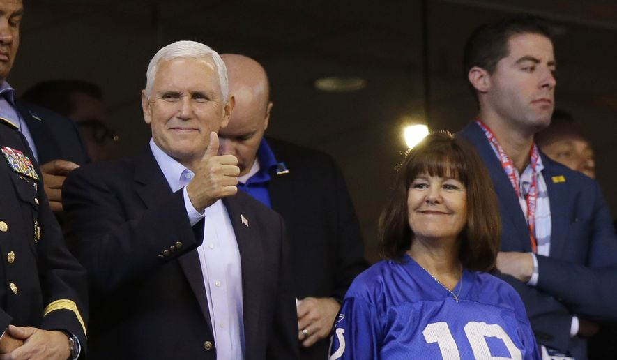 Vice President Mike Pence reacts to fans before an NFL football game between the Indianapolis Colts and the San Francisco 49ers, Sunday, Oct. 8, 2017, in Indianapolis. (AP Photo/Michael Conroy)