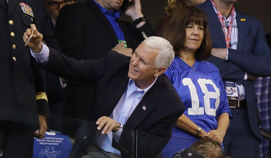 Vice President Mike Pence takes a photo with a fan before an NFL football game between the Indianapolis Colts and the San Francisco 49ers, Sunday, Oct. 8, 2017, in Indianapolis. (AP Photo/Michael Conroy)
