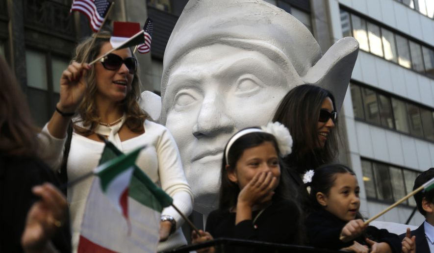 Participants in the Columbus Day Parade ride a float with a large bust of Christopher Columbus in New York. A movement to abolish Columbus Day and replace it with Indigenous Peoples Day has new momentum but the gesture to recognize victims of European colonialism has also prompted howls of outrage from some Italian Americans, who say eliminating their festival of ethnic pride is culturally insensitive, too. (AP Photo/Seth Wenig)