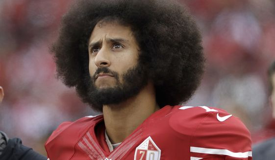 In this Dec. 11, 2016, file photo, San Francisco 49ers quarterback Colin Kaepernick stands in the bench area during the second half of the team's NFL football game against the New York Jets in Santa Clara, Calif. Kaepernick told CBS hell stand during the national anthem if given chance to play football in NFL again. (AP Photo/Marcio Jose Sanchez, File)