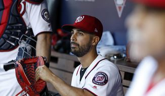 Washington Nationals starting pitcher Gio Gonzalez (47) waits for the start of Game 2 of baseball's National League Division Series against the Chicago Cubs, at Nationals Park, Saturday, Oct. 7, 2017, in Washington. (AP Photo/Alex Brandon)