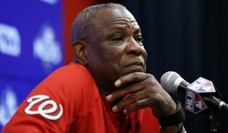 Washington Nationals manager Dusty Baker listens to a question during a media availability before Game 2 of baseball's National League Division Series against the Chicago Cubs, at Nationals Park, Saturday, Oct. 7, 2017, in Washington. (AP Photo/Alex Brandon)