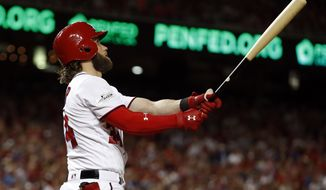 Washington Nationals' Bryce Harper watches his two-run homer in the eighth inning in Game 2 of baseball's National League Division Series against the Chicago Cubs, at Nationals Park, Saturday, Oct. 7, 2017, in Washington. (AP Photo/Alex Brandon)