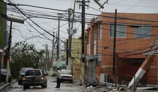 Almost three weeks after winds from Hurricane Maria knocked out Puerto Rico's power grid, the island is running mostly on generator power, with limited cellphone service and debris blocking transportation routes. (Associated Press/File)
