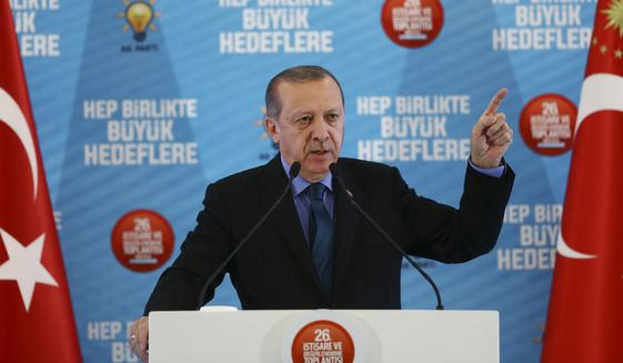 Turkey's President Recep Tayyip Erdogan, gestures as he delivers a speech at his ruling political party's conference in Afyonkarahisar province in western Turkey, Sunday, Oct. 8, 2017. (Pool Photo via AP)