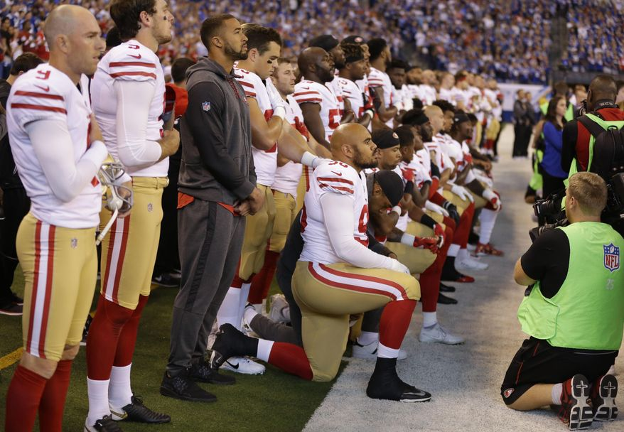 Members of the San Francisco 49ers kneel during the playing of the national anthem before an NFL football game against the Indianapolis Colts, Sunday, Oct. 8, 2017, in Indianapolis. Vice President Mike Pence left the 49ers-Colts game after about a dozen San Francisco players took a knee during the national anthem Sunday. (AP Photo/Michael Conroy)