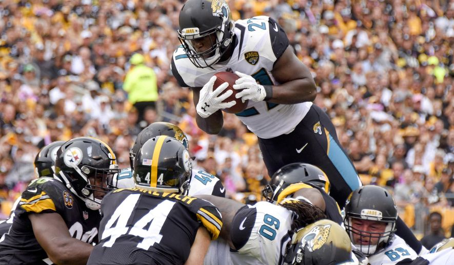 Jacksonville Jaguars running back Leonard Fournette (27) goes over Pittsburgh Steelers outside linebacker Tyler Matakevich (44) and the Steelers defense to score a touchdown in the second quarter of an NFL football game, Sunday, Oct. 8, 2017, in Pittsburgh. (AP Photo/Don Wright)