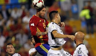 Spain's Sergio Ramos heads the ball above Albania's Frederic Veseli during the World Cup Group G qualifying soccer match between Spain and Albania at the Rico Perez stadium in Alicante, Spain, Friday, Oct. 6, 2017. (AP Photo/Alberto Saiz)