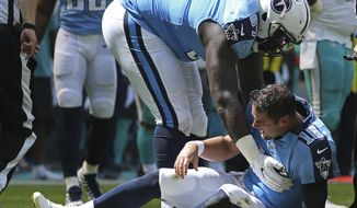 Tennessee Titans offensive guard Quinton Spain (67) helps Tennessee Titans quarterback Matt Cassel (16) to his feet, during the first half of an NFL football game against the Miami Dolphins, Sunday, Oct. 8, 2017, in Miami Gardens, Fla. (AP Photo/Joel Auerbach)
