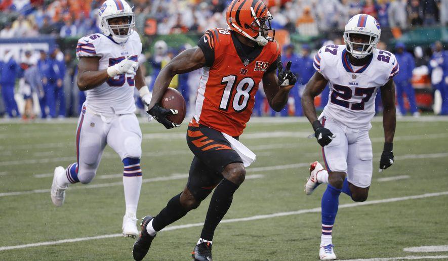 Cincinnati Bengals wide receiver A.J. Green (18) runs the ball against Buffalo Bills cornerback Tre'Davious White (27) in the second half of an NFL football game, Sunday, Oct. 8, 2017, in Cincinnati. (AP Photo/Frank Victores)