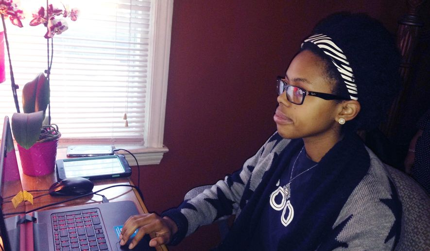 Marianna Campbell navigates the web on her computer at her northwest Detroit home Sunday, Oct. 8, 2017. Campbell, 17, is looking forward to attending workshops, classes and discussions offered by Black Girls CODE which is starting a chapter in Detroit. The nonprofit introduces young black, Latino and Native American females to computer sciences. Girls in the program also learn how to build websites and create mobile apps. (AP Photo/Corey Williams)