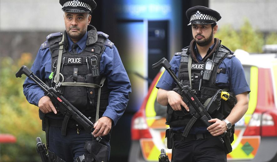 Armed police at the scene on Cromwell Gardens in London, after a car reportedly ploughed into people outside the Natural History Museum in London, Saturday Oct. 7, 2017. Police said a number of people were injured and one person was detained at the scene. (Victoria Jones/PA via AP)