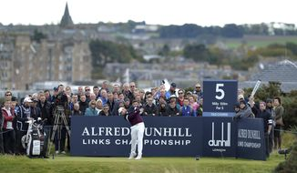 England's Tyrrell Hatton tees off on the fifth hole, during day four of the Dunhill Links Championship at The Old Course at St. Andrews, in Fife, Scotland, Sunday Oct. 8, 2017. (Mark Runnacles/PA via AP)