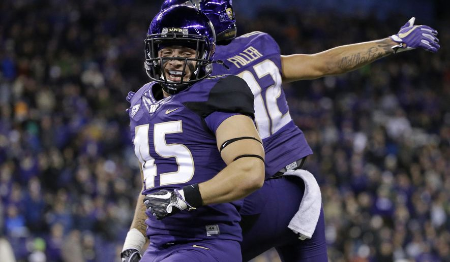 Washington's Jusstis Warren celebrates his touchdown against California with Aaron Fuller in the second half of an NCAA college football game Saturday, Oct. 7, 2017, in Seattle. (AP Photo/Elaine Thompson)