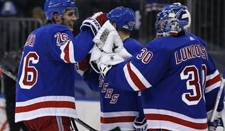 New York Rangers goalie Henrik Lundqvist, of Sweden, celebrates with Rangers' Brady Skjei (76) after defeating the Montreal Canadiens in an NHL hockey game Sunday, Oct. 8, 2017, in New York. The Rangers won 2-0. (AP Photo/Adam Hunger)