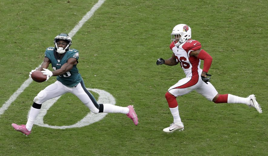 Philadelphia Eagles' Nelson Agholor, left, catches a touchdown pass against Arizona Cardinals' Budda Baker during the second half of an NFL football game, Sunday, Oct. 8, 2017, in Philadelphia. (AP Photo/Michael Perez)