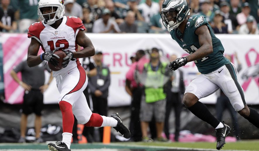 Arizona Cardinals' John Brown, left, scores a touchdown past Philadelphia Eagles' Jalen Mills during the first half of an NFL football game, Sunday, Oct. 8, 2017, in Philadelphia. (AP Photo/Michael Perez)