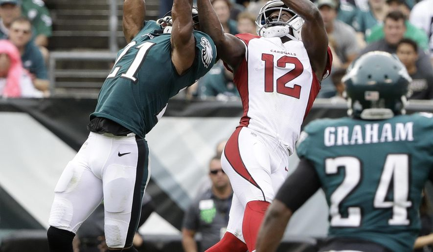Philadelphia Eagles' Patrick Robinson (21) breaks up a pass intended for Arizona Cardinals' John Brown (12) during the second half of an NFL football game, Sunday, Oct. 8, 2017, in Philadelphia. (AP Photo/Matt Rourke)