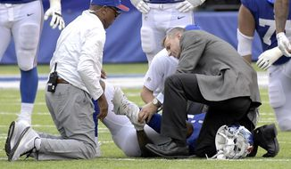 New York Giants wide receiver Odell Beckham holds his leg after suffering an injury during the second half of an NFL football game against the Los Angeles Chargers, Sunday, Oct. 8, 2017, in East Rutherford, N.J. (AP Photo/Bill Kostroun)