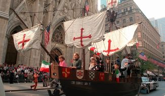 "FILE- In this Oct. 14, 1996, file photo, a model of the ""Santa Maria,"" one of Christopher Columbus' three ships, is pulled up New York's Fifth Avenue in front of St. Patrick's Cathedral during the 56th Columbus Day Parade. A movement to abolish Columbus Day and replace it with Indigenous Peoples Day has new momentum but the gesture to recognize victims of European colonialism has also prompted howls of outrage from some Italian Americans, who say eliminating their festival of ethnic pride is culturally insensitive, too. (AP Photo/Marty Lederhandler, File)"