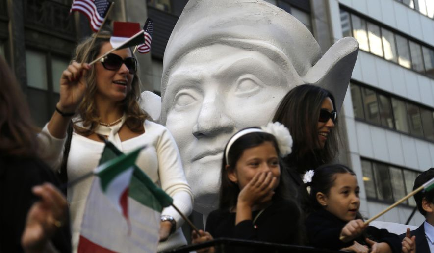FILE - In this Oct. 12, 2015, file photo, participants in the Columbus Day Parade ride a float with a large bust of Christopher Columbus in New York. A movement to abolish Columbus Day and replace it with Indigenous Peoples Day has new momentum but the gesture to recognize victims of European colonialism has also prompted howls of outrage from some Italian Americans, who say eliminating their festival of ethnic pride is culturally insensitive, too. (AP Photo/Seth Wenig)