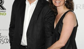 FILE - In this April 3, 2012, file photo, musician Vince Gill and wife, singer Amy Grant, attend the Revlon Concert for the Rainforest Fund dinner and auction at The Pierre Hotel in New York. Many artists have used their voices to pray, to cry and to offer peace and comfort in the wake of the Oct. 1, 2017 mass shooting at a country music festival. Alongside her husband Gill, Grant lead a prayer at a vigil in Nashville on Monday, Oct. 2, a day after the shooting in Las Vegas. (AP Photo/Evan Agostini, File)