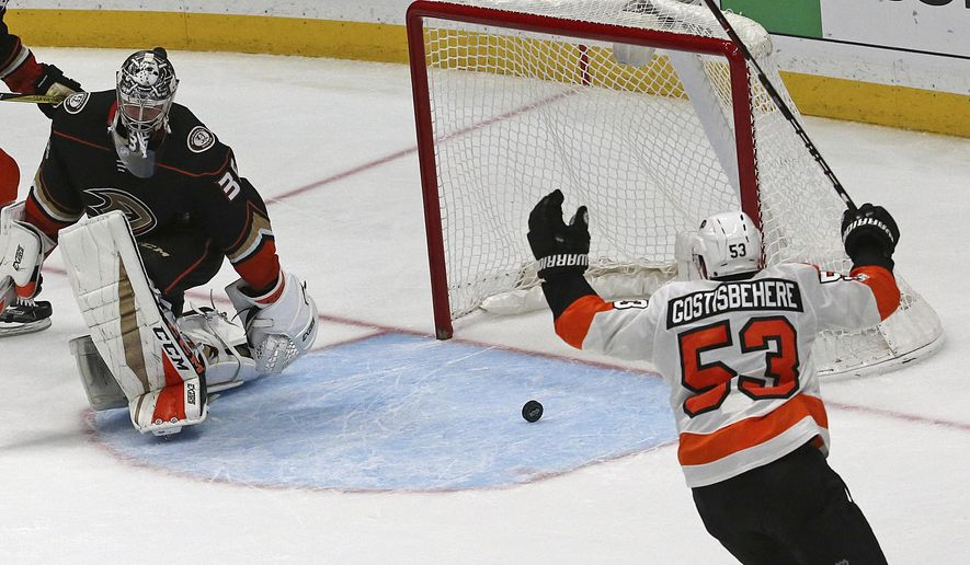 Philadelphia Flyers defenseman Shayne Gostisbehere (53) celebrates their winning goal by right winger Wayne Simmonds, not shown, in overtime against the Anaheim Ducks and goalie John Gibson in an NHL hockey game in Anaheim, Calif., Saturday, Oct. 7, 2017. The Flyers won in overtime, 3-2. (AP Photo/Reed Saxon)