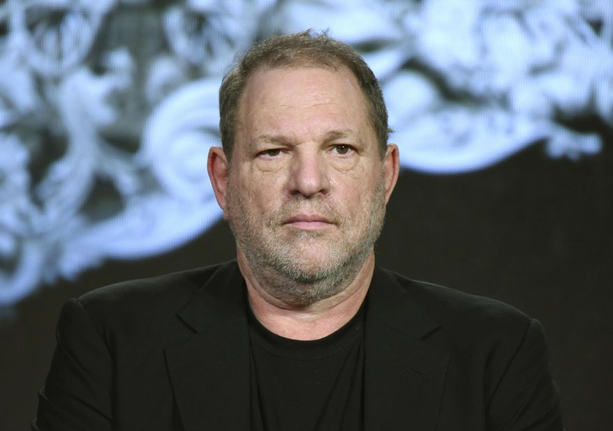 """FILE - In this Jan. 6, 2016 file photo, producer Harvey Weinstein participates in the """"War and Peace"""" panel at the A&E 2016 Winter TCA in Pasadena, Calif. Weinstein has been fired from The Weinstein Co., effective immediately, following new information revealed regarding his conduct, the company's board of directors announced Sunday, Oct. 8, 2017. (Photo by Richard Shotwell/Invision/AP, File)"""