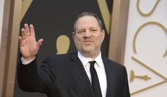 In this March 2, 2014, file photo, Harvey Weinstein arrives at the Oscars in Los Angeles. Weinstein has been fired from The Weinstein Co., effective immediately, following new information revealed regarding his conduct, the company's board of directors announced Sunday, Oct. 8, 2017. (Photo by Jordan Strauss/Invision/AP, File)