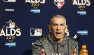 New York Yankees manager Joe Girardi gestures during a news conference before an American League Division Series baseball game against the Cleveland Indians in New York, Sunday, Oct. 8, 2017. (AP Photo/Kathy Willens)