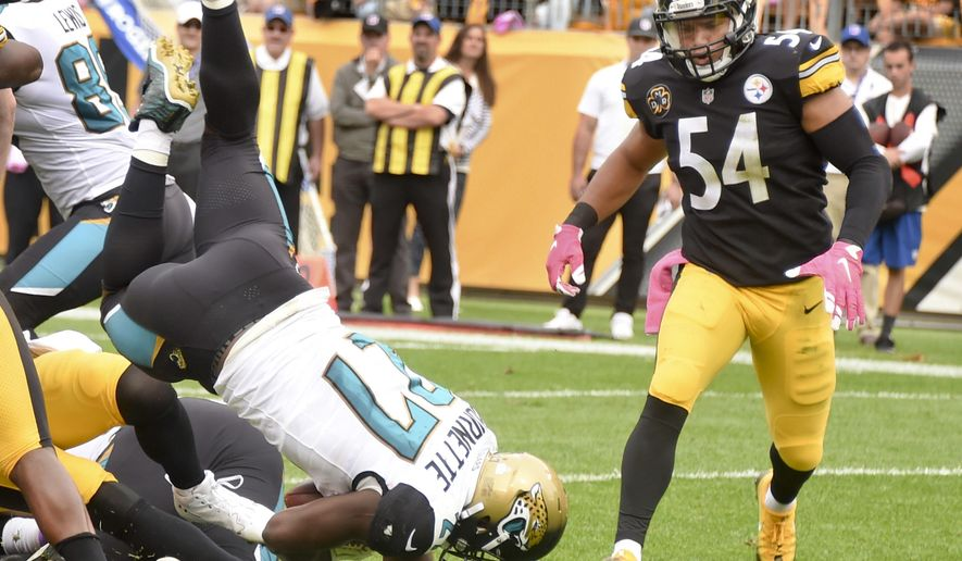 Jacksonville Jaguars running back Leonard Fournette (27) lands in the end zone to score a touchdown in front of Pittsburgh Steelers linebacker L.J. Fort (54) in the second quarter of an NFL football game, Sunday, Oct. 8, 2017, in Pittsburgh. (AP Photo/Fred Vuich)