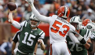 New York Jets quarterback Josh McCown (15) passes against Cleveland Browns outside linebacker Joe Schobert (53) during the first half of an NFL football game, Sunday, Oct. 8, 2017, in Cleveland. (AP Photo/Ron Schwane)
