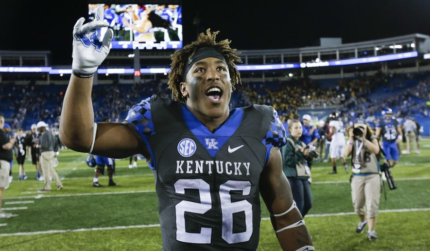 Kentucky running back Benny Snell Jr. celebrates as he leaves the field after an NCAA college football game against Missouri Saturday, Oct. 7, 2017, in Lexington, Ky. Kentucky won the game 40-34. (AP Photo/David Stephenson)