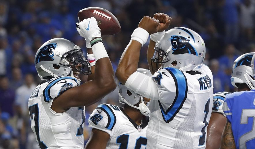 Carolina Panthers wide receiver Devin Funchess (17), and quarterback Cam Newton (1) celebrate after Funchess' 10-yard pass for a touchdown during the first half of an NFL football game against the Detroit Lions, Sunday, Oct. 8, 2017, in Detroit. (AP Photo/Paul Sancya)
