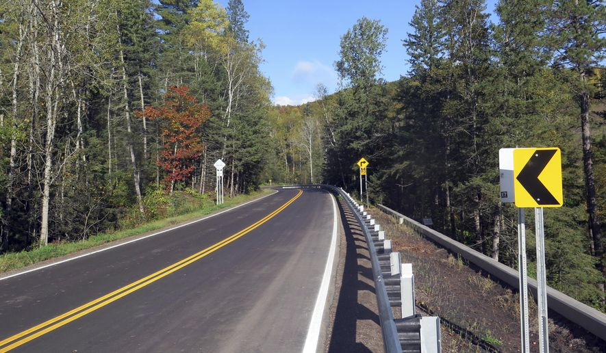 This Wednesday, Oct. 4, 2017 photo shows Highway 210 through Jay Cooke State Park in Duluth, Minn. Thehighway that runs along a steep ridge above the St. Louis River has finally reopened, five years after mudslides washed out the highway, the only one that runs through Jay Cooke State Park.  (Dan Kraker   /Minnesota Public Radio via AP)