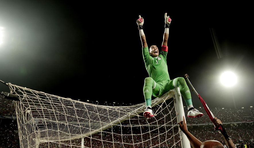 Egypt's goalkeeper Essam El Hadary celebrates after defeating Congo in the 2018 World Cup group E qualifying soccer match at the Borg El Arab Stadium in Alexandria, Egypt, Sunday, Oct. 8, 2017. Egypt won 2-1. (AP Photo/Nariman El-Mofty)