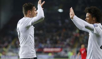Germany's Leon Goretzka, left, celebrates with his teammate Leroy Sane after scoring his side's fourth goal during the 2018 World Cup qualifying Group C soccer match between Germany and Azerbaijan in Kaiserslautern, Germany, Sunday, Oct. 8, 2017.(AP Photo/Michael Probst)