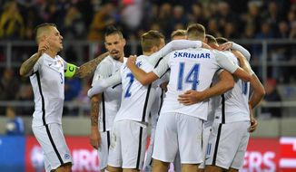 Slovakia's Adam Nemec, right, celebrates with teamates Martin Skrtel, left, Marek Hamsik, second left, and others after scoring his second goal during their WCup 2018 Group F qualifying soccer match between Slovakia and Malta in Trnava, Slovakia, Sunday, Oct. 8, 2017. (Michal Svitok/TASR via AP)