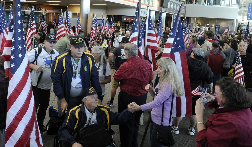 In this Monday, Oct. 2, 2017 file photo, veterans were treated to a big arrival celebration at the Medford airport after returning from an Honor Flight to Washington, D.C.  (Andy Atkinson/The Medford Mail Tribune via AP) **FILE**