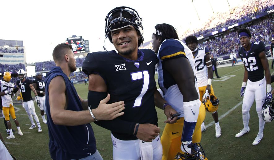 TCU quarterback Kenny Hill (7) celebrates following an NCAA college football game against West Virginia Saturday, Oct. 7, 2017, in Fort Worth, Texas. TCU won 31-24. (AP Photo/Ron Jenkins)