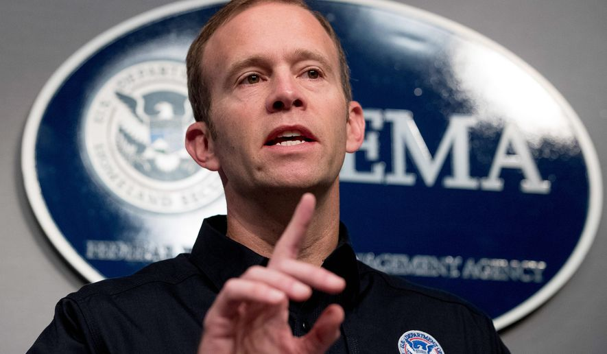 Federal Emergency Management Agency Administrator Brock Long speaks at FEMA headquarters in Washington, Tuesday, Sept. 12, 2017, to give an update on federal government support in the aftermath of Hurricane Irma. (AP Photo/Andrew Harnik)