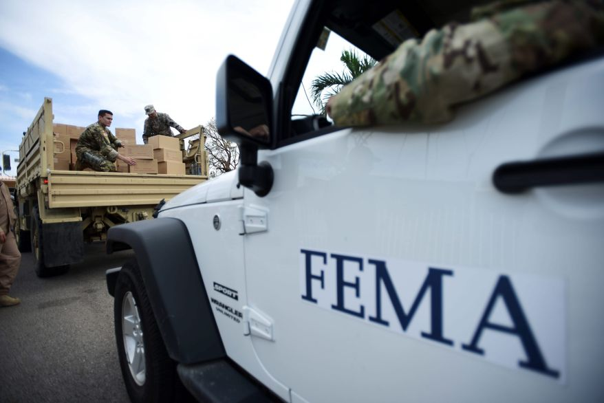 "The director of the Federal Emergency Management Agency Department says employees are suffering ""battle fatigue"" after a rash of hurricanes has taxed his staff. (Associated Press)"