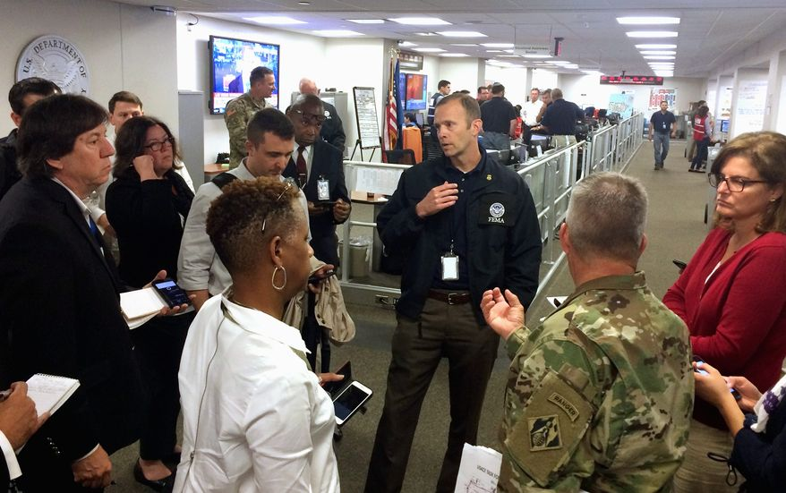 FEMA Administrator Brock Long briefs reporters at the National Response Coordination Center in FEMA Headquarters, Monday October 9, 2017 in Washington. (AP Photo/Luis Alonso Lugo)