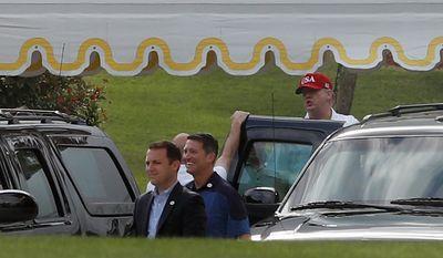 President Donald Trump gets inside a vehicle as he departs Mar-a-Lago, Sunday, April 9, 2017, in Palm Beach, Fla. (AP Photo/Alex Brandon)