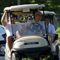 President Barack Obama steers the cart with his golfing partner, Vice President Joe Biden, left, as they finish 18 holes at the Fort Belvoir Golf Club together on Father's Day, Sunday, June 21, 2009. (AP Photo/J. Scott Applewhite)